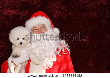 Santa Claus. Santa Claus. Santa Claus poses with a Dog for a Christmas Photo Shoot. Gold Sequin background. Christmas holiday images. Dogs love Santa.  #1238885152