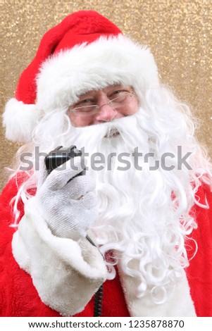 Santa Claus. Santa Claus. Santa Claus uses the microphone of his CB Radio, Short Wave Radio or Willkie Talkie while talking to his fans around the world. Gold Sequin Background. Christmas Images. #1235878870