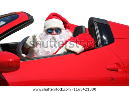 Santa Claus. Santa Points at You the Viewer as he drives his Red Hot Rod Sports Car.