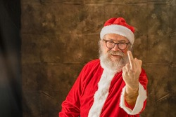 Santa Claus show the finger due to unability to delivere gifts b