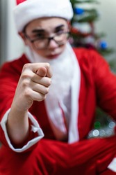 santa claus shows fig. focus on the hand. spoiled christmas. cancellation of New Year's holidays. Christmas in quarantine due to coronavirus