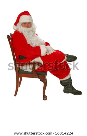Santa Claus sits in his chair and waits for you to tell him what you want for christmas  isolated on white