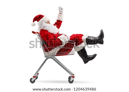 Santa Claus sitting inside a shopping cart isolated on white background