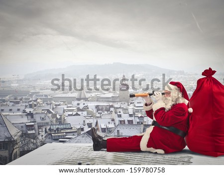 Stock Photo Santa Claus sitting over the city looking through spyglass