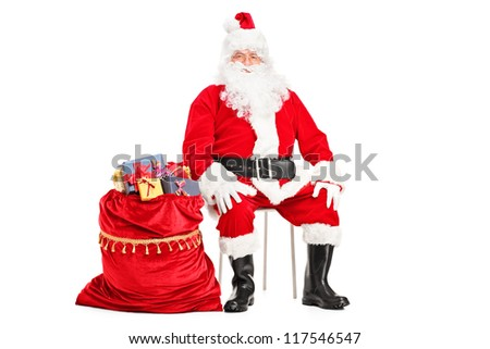 Santa Claus sitting with bag full of presents isolated on white ...