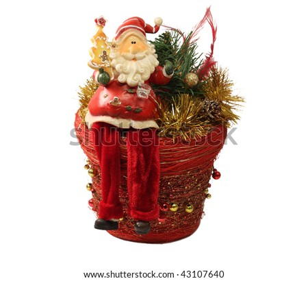 Santa Claus sitting with box gift pine toys on white background