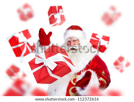 Santa Claus standing and doing magic Gift boxes falling down around him