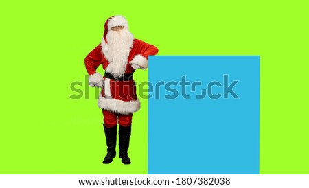 Photo of  Santa Claus standing on green screen and blue screen for your text or animations, Chroma key