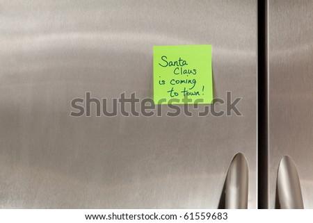 Santa Claus sticky note on a refrigerator