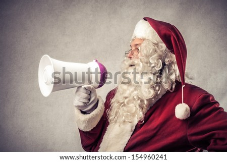 Santa Claus talking with megaphone