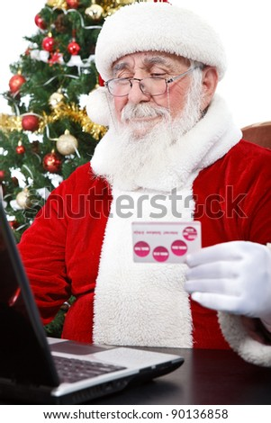 Santa Claus using computer purchasing on internet paying with credit card