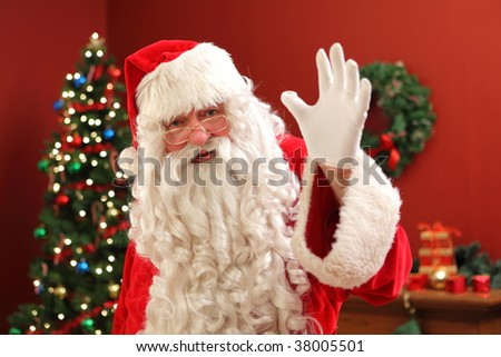 Santa Claus waving at camera