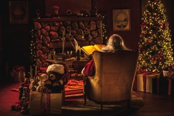Santa Claus wide angle of him working in the north pole in his office on the naughty or nice list