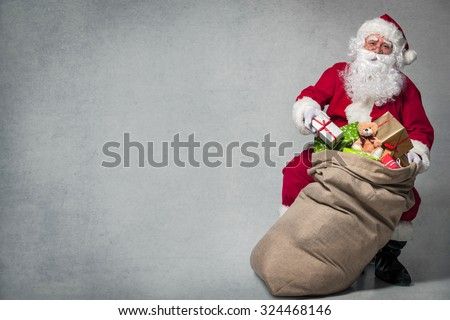 Santa Claus with a bag full of presents #324468146