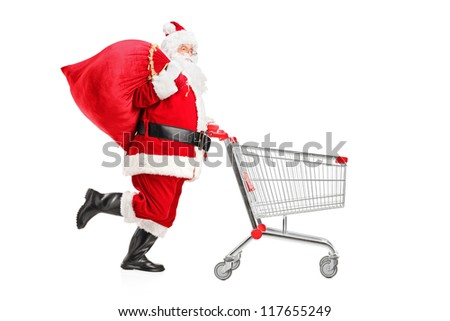 Santa Claus with a bag on his shoulder pushing an empty shopping cart isolated on white background