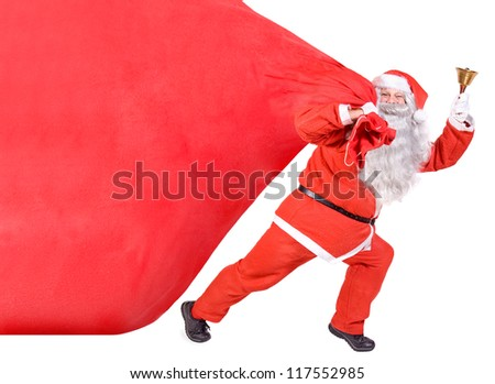 Santa Claus with bell carries a bag isolated on white background. Cheerful Santa brings a sack of Christmas gifts and bells ringing. Christmas coming. - Shutterstock ID 117552985