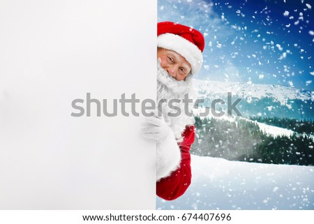 Santa Claus with blank poster on blurred background #674407696