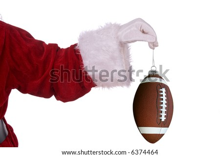 Santa Claus with football ornament in his white gloved hand