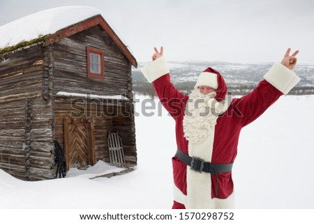 Santa Claus with his arms raised in the air