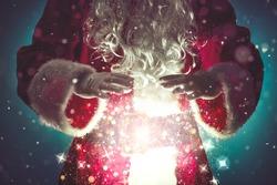 Santa Claus with magic Christmas lights,Christmas concept