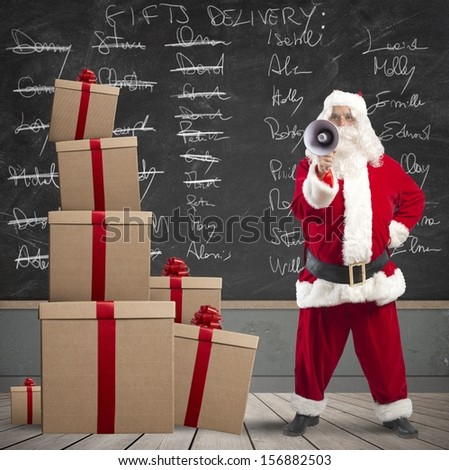 Santa Claus with megaphone with list of gifts delivery in a blackboard