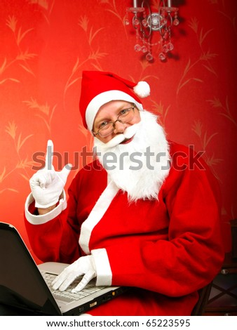 santa claus with notebook and finger up