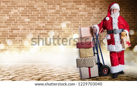 Santa Claus with presents on a delivery trolley in a postal theme with festive lighting and an industrial background.