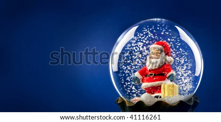 Santa Claus with snow in a sphere