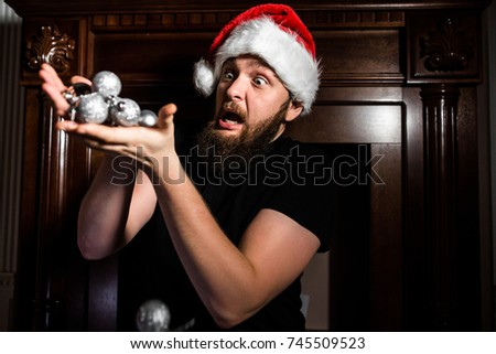 Santa Claus with surprise keeps Christmas toys on wooden background #745509523