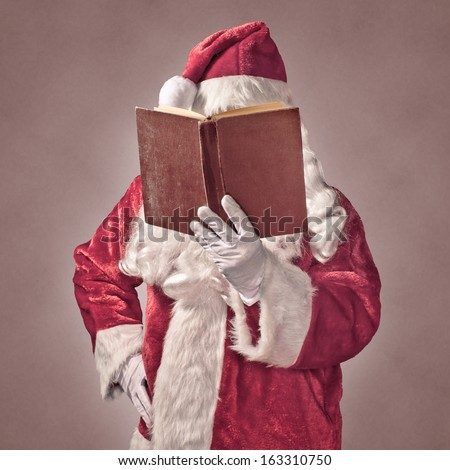 Santa Claus with vintage book