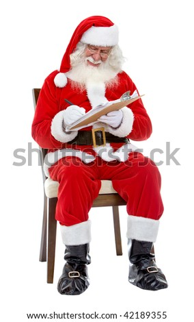Santa Claus writing a Christmas list isolated over a white background