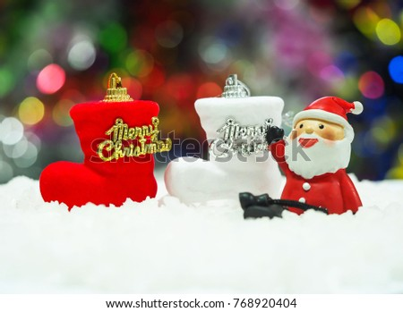 Santa Clause sitting on the white snow  with gifts waiting for Christmas, happy and prosperity concept