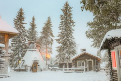 Santa Clause village house with Christmas tree in winter, Lapland Finland