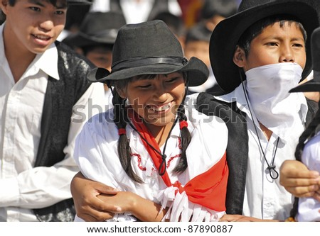 SANTA CRUZ, BOLIVIA- JUNE 7: Unidentified traditionally dressed youngsters perform in a folkloric dance on June 7, 2010 in Santa Cruz, Bolivia. This event celebrates teachers day in Bolivian schools each year.