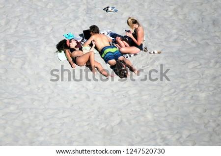 SANTA CRUZ, CA. APRIL 23, 2017. CIRCA: Tourist enjoying the beach in Santa, Ca. #1247520730