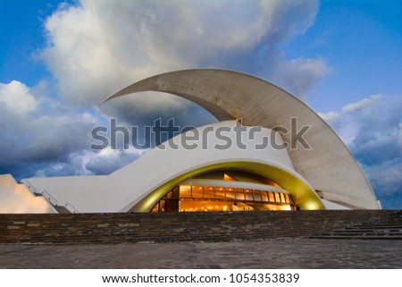 Santa Cruz de Tenerife, Canary Islands, Spain - February 20 2018: Auditorio de Tenerife, iconic landmark - opera house of Santa Cruz de Tenerife in organic shapes, designed by Santiago Calatrava #1054353839