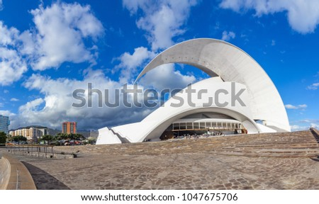 Santa Cruz de Tenerife, Canary Islands, Spain - February 8, 2018: Auditorio, iconic landmark - opera house of Santa Cruz de Tenerife, built in 2003 in organic shapes, designed by Santiago Calatrava #1047675706