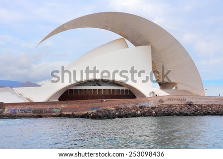 SANTA CRUZ, SPAIN - OCTOBER 27, 2012: People visit Auditorio de Tenerife building in Santa Cruz de Tenerife. The arts complex was designed by famous Santiago Calatrava and completed in 2003. #253098436