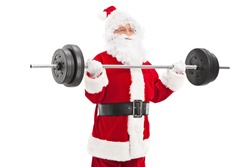 Santa exercising with a heavy barbell isolated on white background