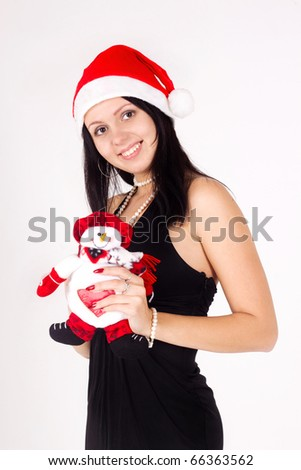 Santa girl holding a snowman. Holidays New Year and Christmas