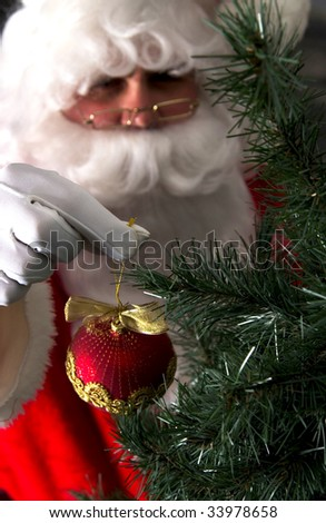 santa hanging ornament on christmas tree