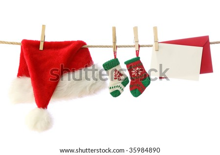 Santa hat,christmas socks and blank note isolated on white background