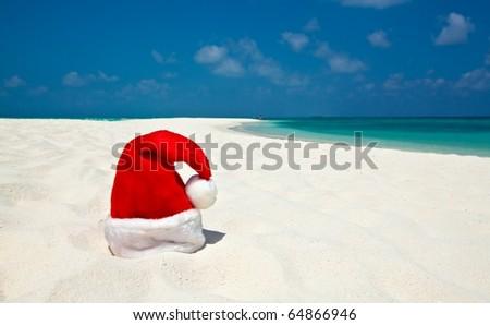 Santa hat is on infinity coral sandy beach