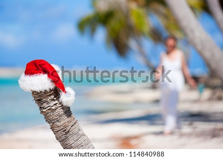 Santa hat on a beach at tropical island - stock photo