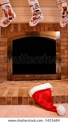 Santa Hat on Fireplace Hearth at Christmas