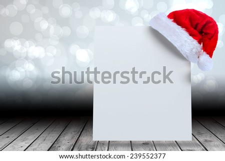 Santa hat on poster against light glowing dots design pattern
