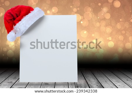Santa hat on poster against yellow abstract light spot design