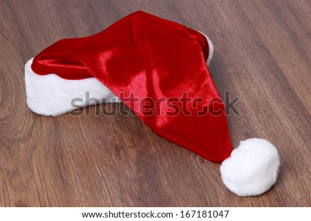 santa hat over wooden background on Holiday theme/Christmas hat over wooden background