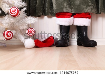 Santa hiding behind a curtain