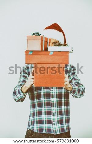 Santa holding gifts. #579631000